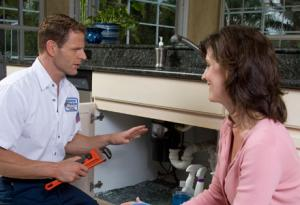 Mike, one of our Henderson plumbers is talking to the client regarding the repairs he did